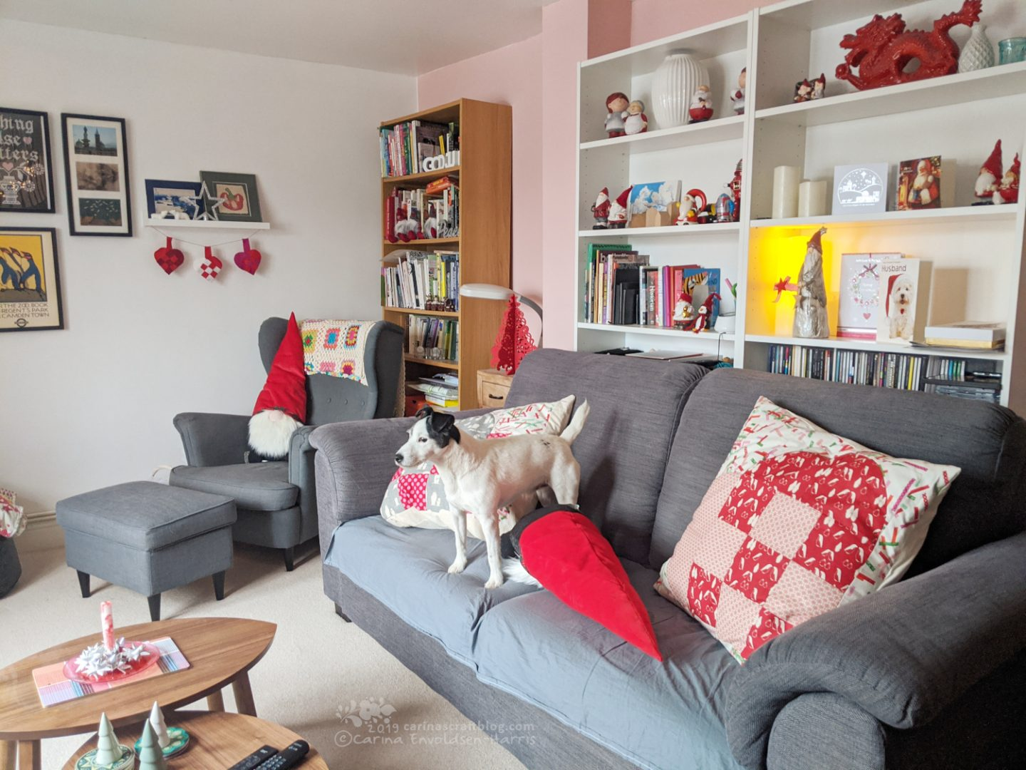Dog standing on sofa, cushions falling all over the place.