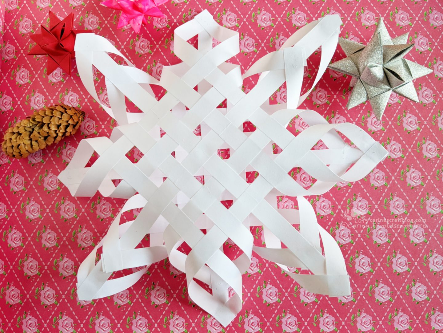 Woven paper star Christmas tree topper.